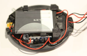 photo of battery and charge control circuitry in the headphbone baffle